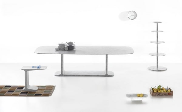 soft square dining table in marble and accessories design by James Irvine