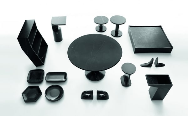 round dining table and accessories in black marble design by Jasper Morrison