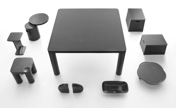 tables and accessories in black marquina marble design by Naoto Fukasawa